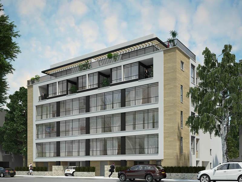 """מבנה בניין דירות חדש על רקע שמיים כחולים ענף מהנדסים בע""""מ"""