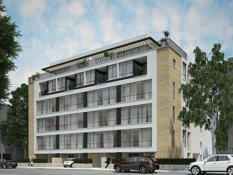 מבנה בניין דירות חדש על רקע שמיים כחולים ענף מהנדסים בע